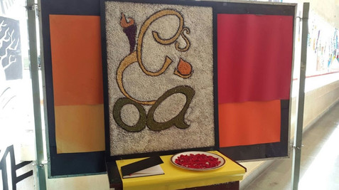 Frame made out of severals variation of pulses and food grains. The design depicted the initials of my college 'IES COA' . The alphabets were arranged in such a way that its created an abstract outline of lord Ganesha,  a diety worshipped by hindus in India