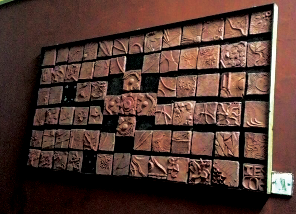 """Frame made out of 4"""" x 4"""" clay tiles of designs made by pinching method of pottery"""