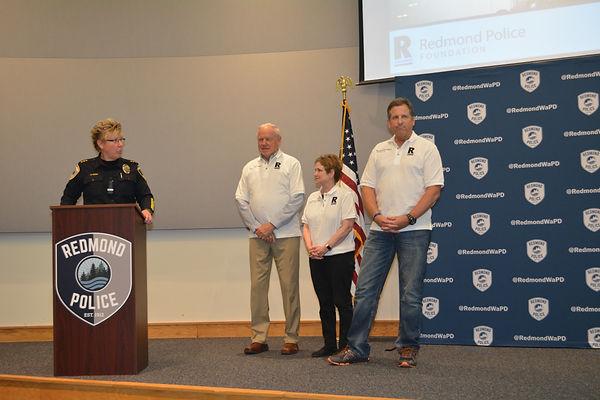 Chief Kristi Wilson, Leo Poort, Gigi Braucher and Redmond Police Foundation Board President Jeff Wallis at the 2018 Redmond Police Recognition ceremony