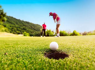 golfer-focus-putting-golf-ball-into-hole