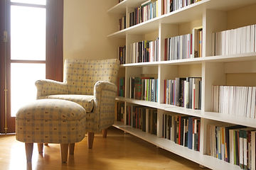 Home library with arm chair. Clean and m