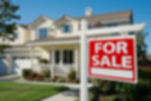 Home For Sale Real Estate Sign in Front