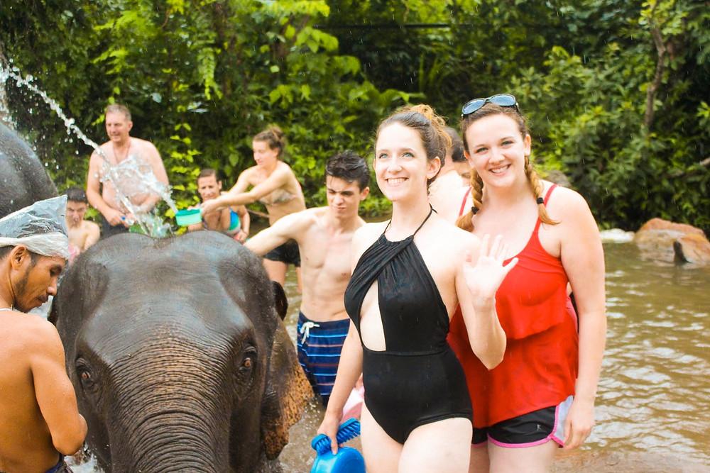 Me and Rachel posing during the elephant bath at Elephant Jungle Sanctuary