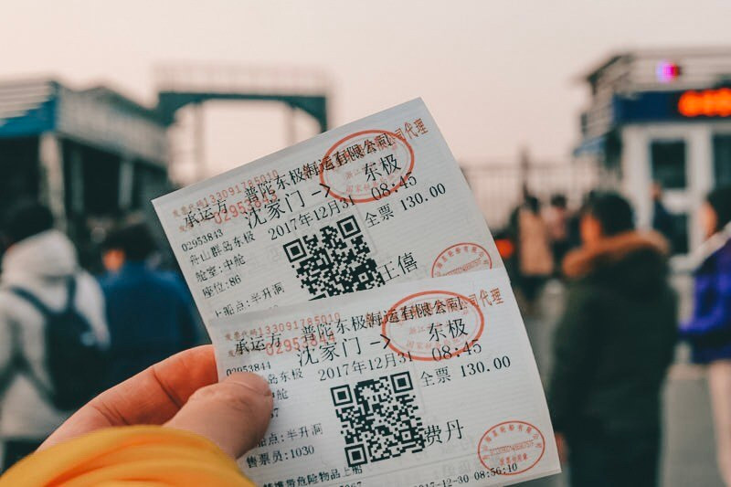 Person holding two tickets