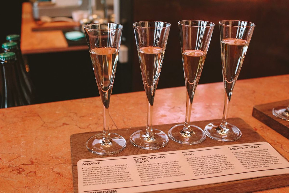 Four champagne glasses with traditional Swedish spirits