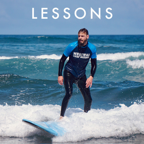 Surf lessons in Auckland