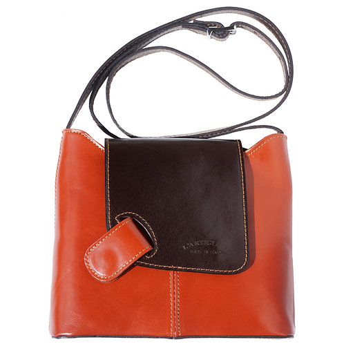 Patent shoulder bag with folded flap closure and a magnetic button