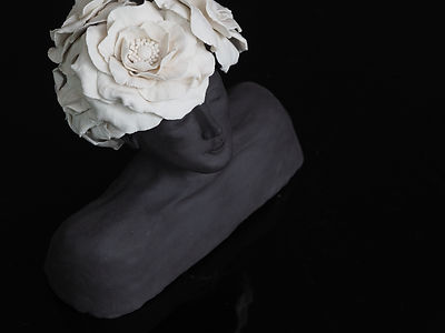 Bust sculpture with porcelain flowers