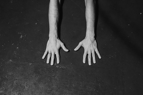 The Hands Of A Ballet Dancer On The Ground
