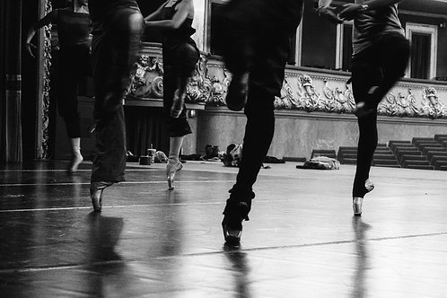 Dancers Practicing Pirouettes During The Class