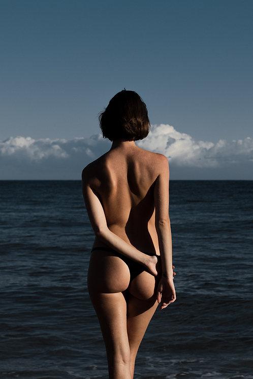 Woman Facing The Sea