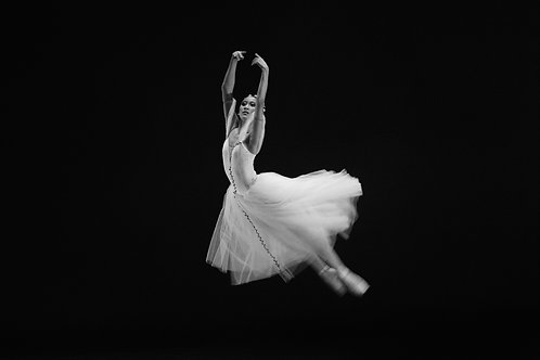 Ballerina Floating on Stage