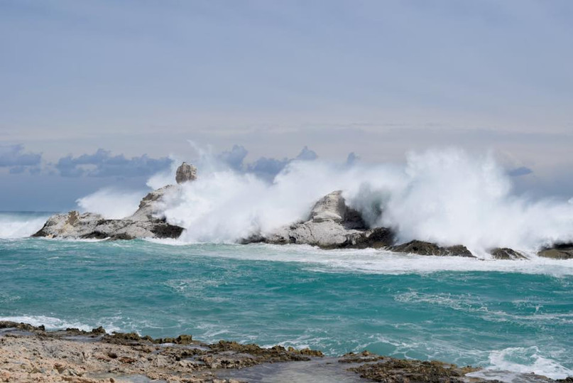 Crashing waves against Chimney Rock