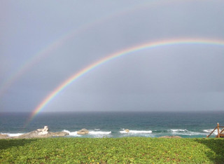 Rainbows, a common sight, over Chimney Rock
