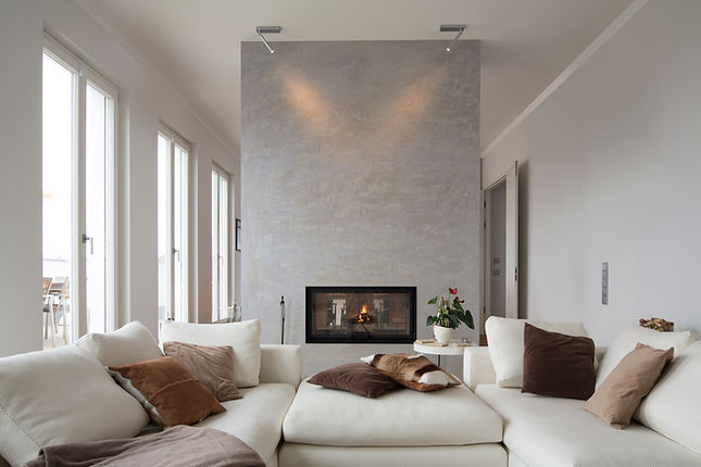 A living room with a fireplace, Hammerhouse Construction