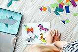children creating a puzzle