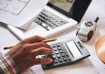 Hands of engineer calculating budget est