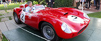 A classic red Ferrari loads out from the Concorso d'Eleganza during Cavallino 26.