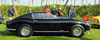Picture of a classic black Ferrari from Cavallino 26.
