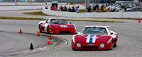 Two Ferraris race at Palm Beach International Raceway.