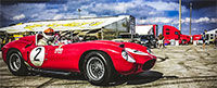 Day 2 - picture of a classic red Ferrari from Grand Touring Magazine.