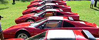 A row of red Ferraris - thumbnail of Bloomberg's best business photo featuring the Cavallino Classic.