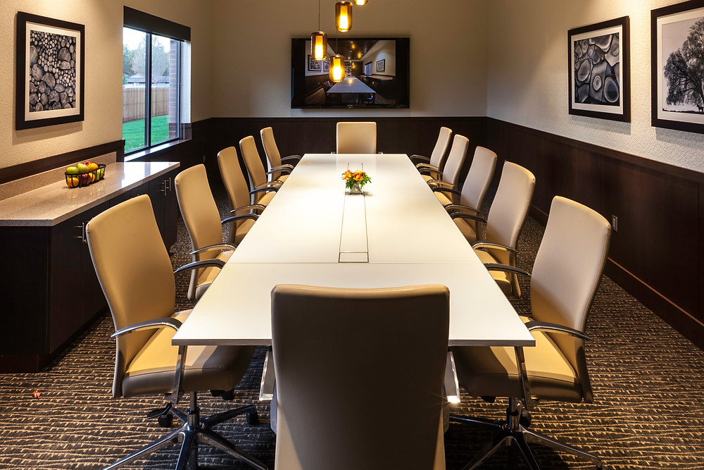 Conference table in sophisticated office setting photographed by architectural photographer Cheryl McIntosh