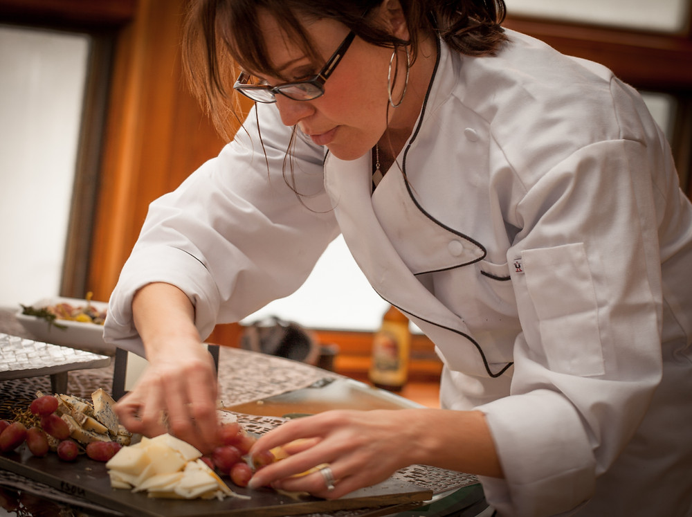 Chef Cheryl McIntosh assembling cheese plater