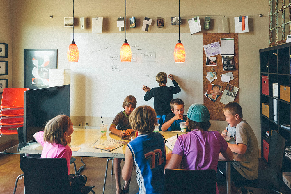 kids working at an advertising agency photographed by Oregon photographer Cheryl McIntosh