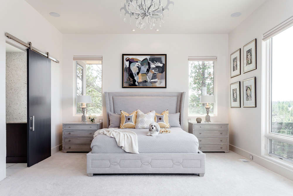 Chic all white bedroom and fine art collection photographed by Cheryl McIntosh Portland and Bend photographer