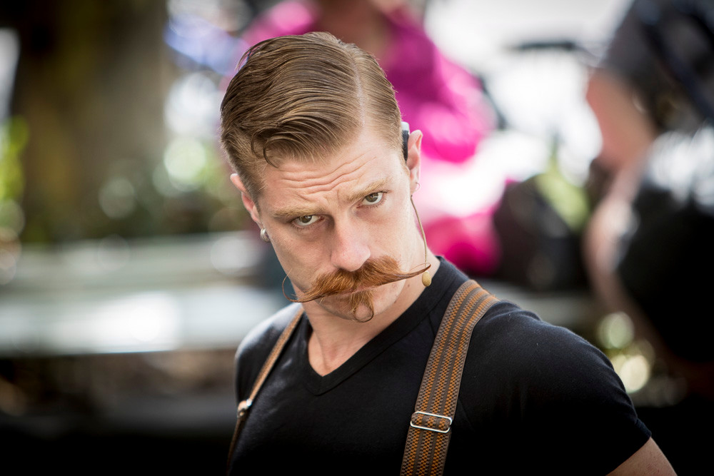 A street performer in Melbourne's CBD. To do this you need a great deal of skill, but also masses of confidence in yourself (and the moustache helps!). He has both & I certainly have the confidence in what I'm doing (if not quite as impressive upper lip hair)!