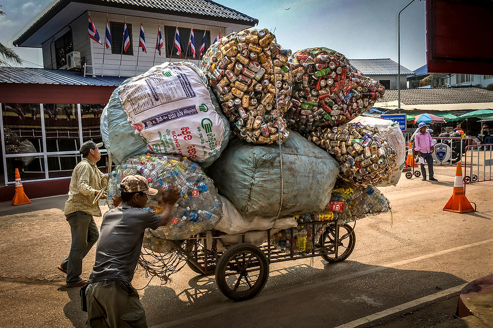 It's hard work recycling - they are bringing cans from Cambodia over the border into Thailand