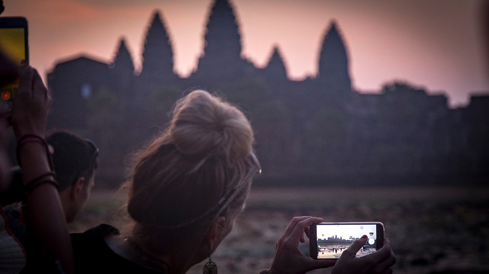 Sunrise at Angkor Wat, a sight attended by thousands & unless you get up & reserve your place by the pool, as it were, this is the only photo you'll get!