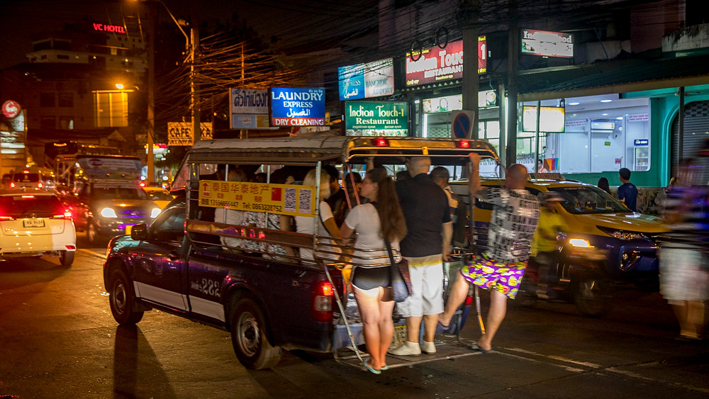 Taxi in Pattaya - No room left in the cab? No worries - just hang off the back.