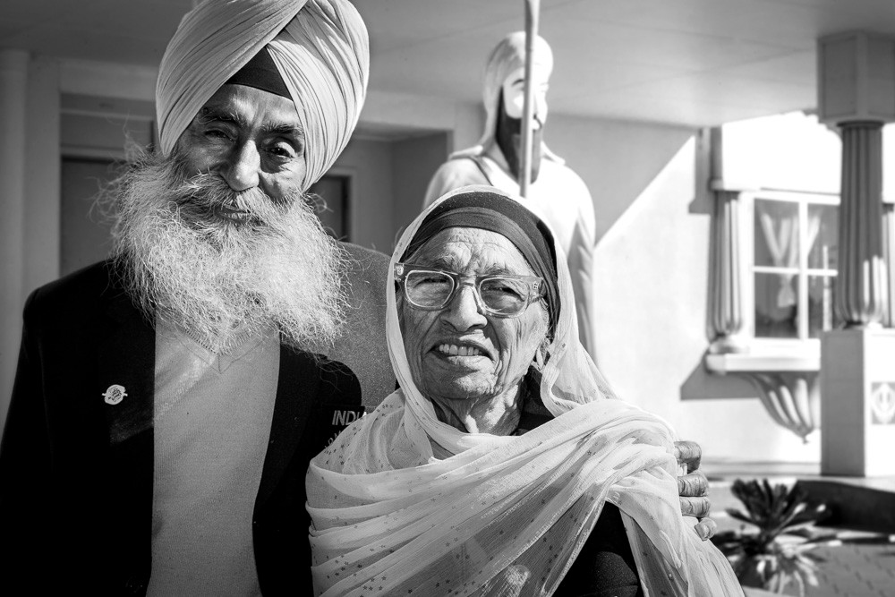 Man Kaur - at 101 the oldest female athlete in the world - with her son