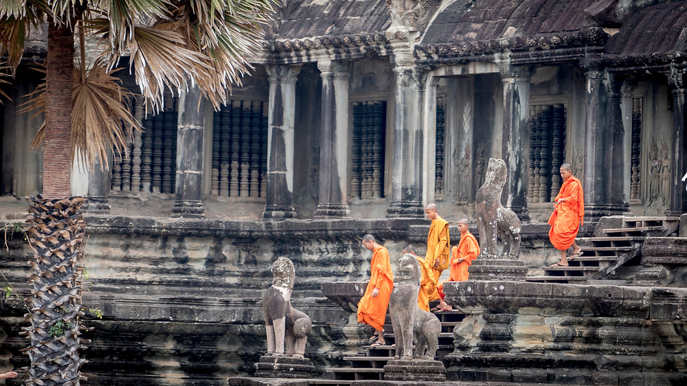 Buddhist monks make their way through the Angkor Wat complex