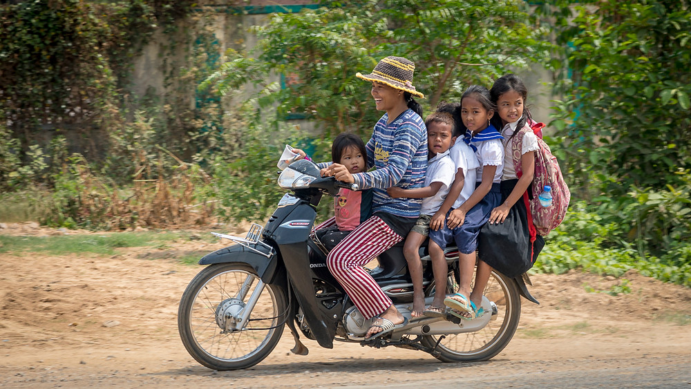Six on one moped? Only in Cambodia (or possibly Thailand). They learn to ride & balance from a ridiculously young age