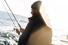 handsome-young-man-fisherman-wearing-coa