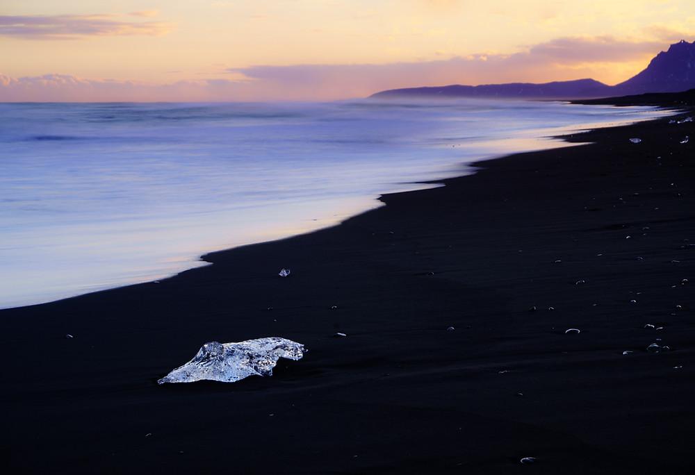 black beach with ice