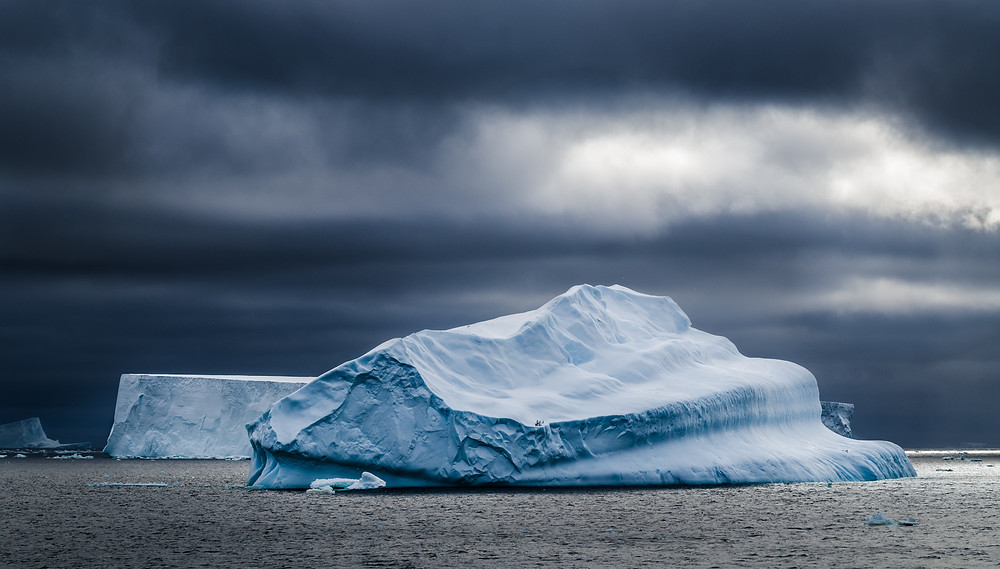 iceberg in storm with black dots