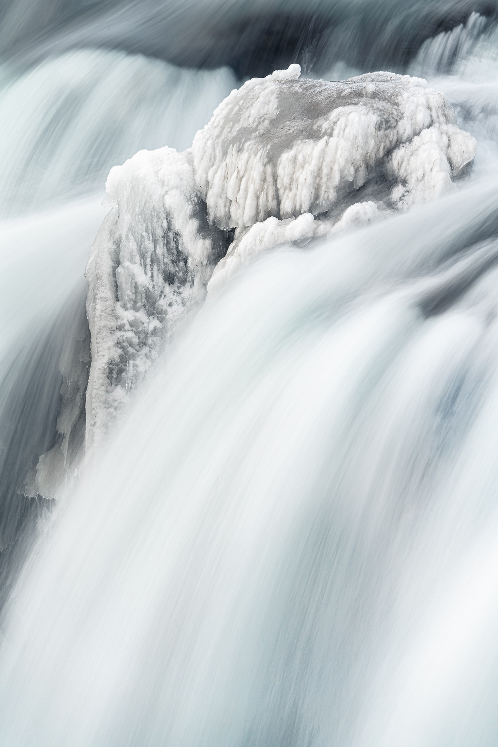Ice and water of a waterfall