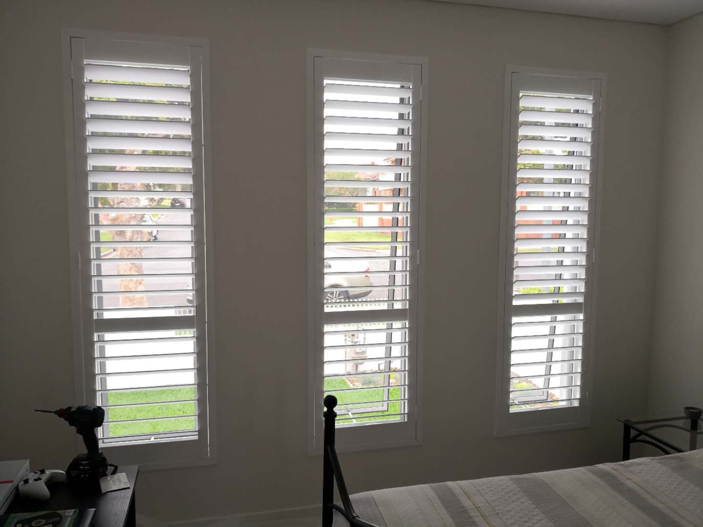 Plantation shutter for tall window