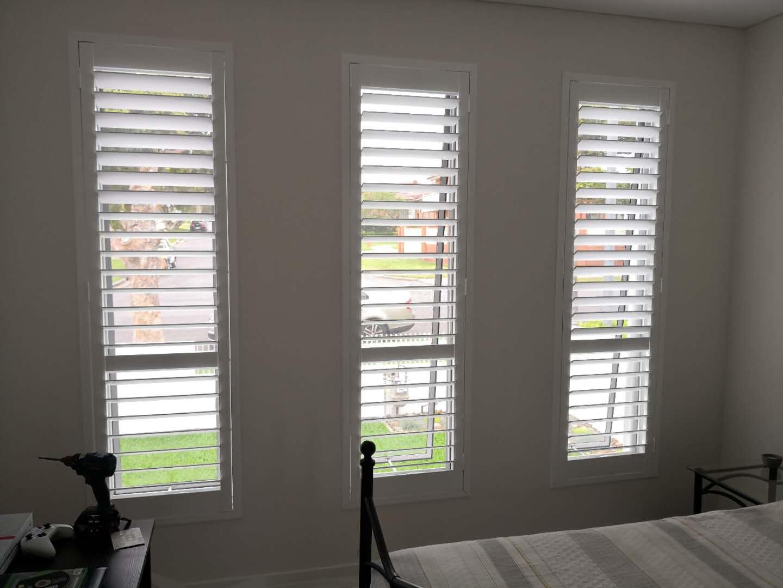 Plantation shutter for tall window