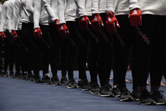 Rutger's women's gymanstics team stands onstage for the singing of the national anthem at the Big Ten Women's Gymnastics Championships on Saturday, March 23, 2019 in Rec Hall. Out of the ten schools that competed, Rutgers placed last in the national meet.
