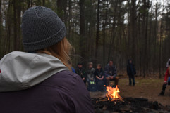 Lauren Jardine sits with her campers at campfire for a night of songs and skits at Camp Blue Diamond on Wednesday, April 10, 2019. Jardine volunteered to be a counselor for Outdoor School, a program through Penn State that educates 5th graders in Pennsylvania about nature.