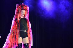 """Ricky """"Bonzai Bucket"""" Watts performs in a student drag show in Heritage Hall on Saturday, March 23, 2019. Watts started drag in April of 2017 and tries to use everyday materials as drag can be a very cost demanding creative outlet."""