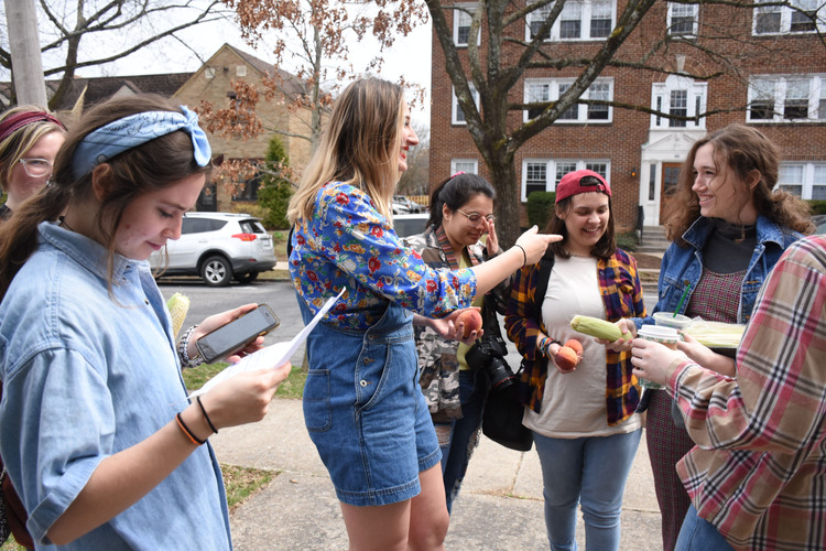 "Members of Derby prepare for a day of shooting their comedic music video ""Georgia Peach, Pennsylvania Corn Cob"" on Sunday, April 7, 2019 on Fairmount Avenue, State College. Derby was created in order to provide a supportive and safe space for women to write and perform comedy. Left to right, Molly Shilling, Kristen Nodell, Julie Larsen, Chelsea West, Rachel Hobbs, Torin Cronin, and Kellie Hahn."