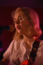 Lindsey Jordan sings with her band Snail Mail at an intimate concert for Penn State music club, Asylum, at Webster's Bookstore Cafe on Friday, April 12, 2019. Snail Mail co-headlined the club's end-of-semester concert with Remo Drive.