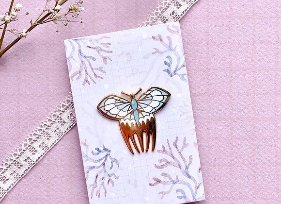 Pin's - Peigne papillon