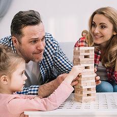 family-playing-with-block-wooden-game-on